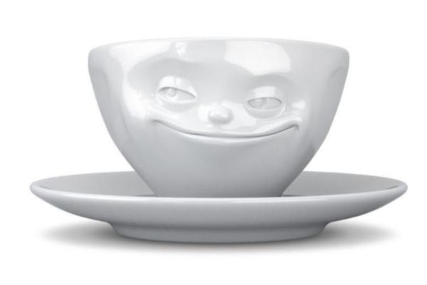 Prezenty świąteczne dla miłośników kawy i herbaty. Uśmiechnięta filiżanka